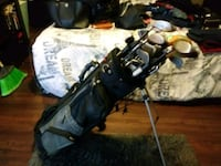 black and gray golf bag with golf clubs Houston, 77093