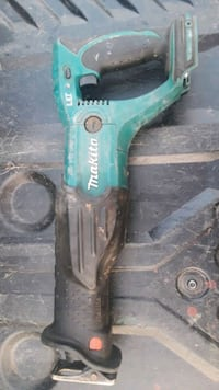 green and black Makita angle grinder 2229 mi