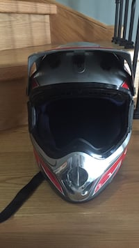 Gray and red helmet