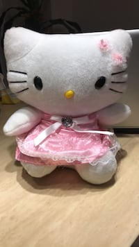White and pink hello kitty plush toy