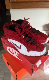 Pair of red-and-white nike basketball shoes size 10 Hillview, 40229