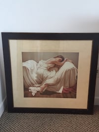 Woman in white dress sitting on sofa with frame good for Christmas present  Toronto, M6S 5B7
