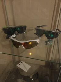 Green, gray and white framed sunglasses
