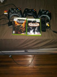 2 Xbox 360 controllers with remote 2 games