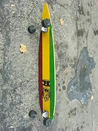 green, yellow, and red longboard