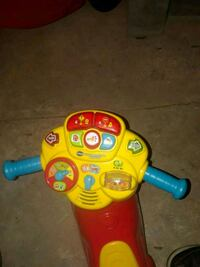 toddler's yellow and red ride-on toy