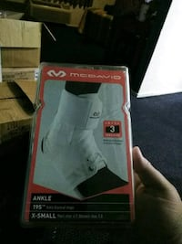 White ankle brace with strap