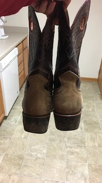 pair of brown leather cowboy boots Ames, 50014