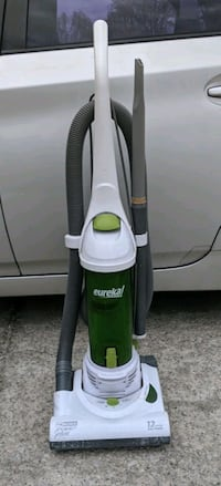 green and gray Eureka upright vacuum cleaner