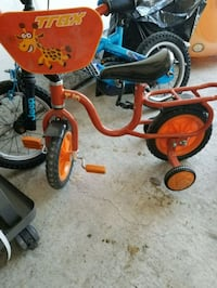 toddler's red and black trike Ajax, L1Z 1G9