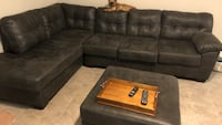 Black suede sectional couch with ottoman new from Ashley must sale moving Riverview, 33578