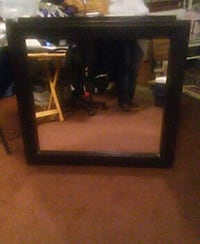 Mirror with a wooden frame.