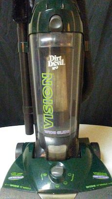 green and gray Vision upright vacuum cleaner