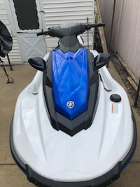 white and blue motor scooter