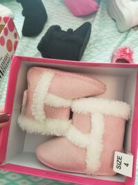 pair of white fur boots null