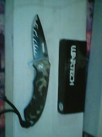 black and gray folding knife