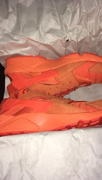 Pair of triple red nike huarache shoes with box size 11.5