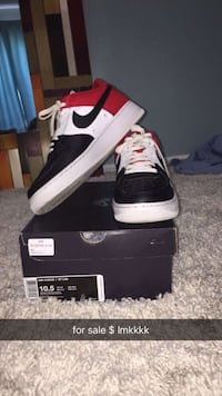 Pair of black nike air force 1 low with box