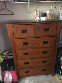 brown wooden 4-drawer chest Calgary, T3K 5W1