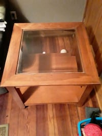 Coffee Table with beveled edge glass top.