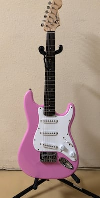 Pink and white squier stratocaster electric guitar