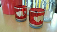 two red glass candle holders