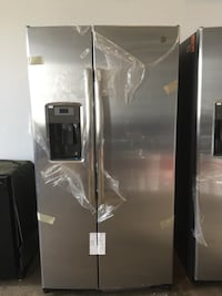 GE 25.3 cu ft Side by side refrigerator New