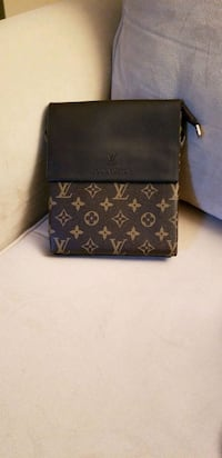 black and brown Louis Vuitton leather wallet Laval, H7K 3L7