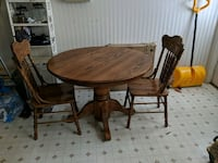 Solid Oak kitchen table with 2 chairs. Matamoras, 18336