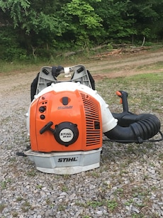 orange, white and black Stihl leaf blower