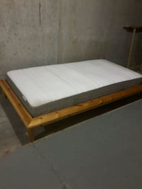 brown wooden twin bed frame.