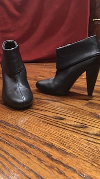 Pair of women's black leather cone-heeled booties