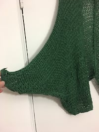 Women's green knit poncho