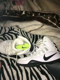 pair of white-and-black Nike basketball shoes Summerfield, 34491