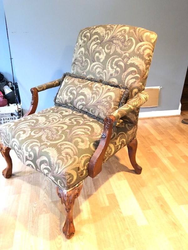 brown and gray floral padded armchair