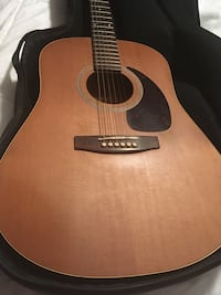 Brown and black acoustic guitar Brampton, L6Y 0S7
