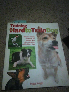 Training Hard to Train Dog by Peggy Swager