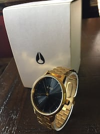 Nixon round gold analog watch with gold link bracelet Tehachapi, 93561