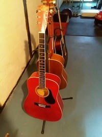 three red and brown acoustic guitars
