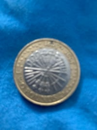 round silver-colored coin Manchester, M19 1GL