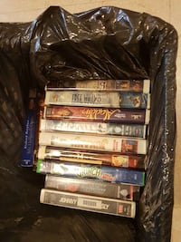 pile of movie VHS tape cases