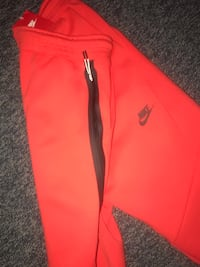 red and black Nike pants