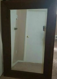 wall mirror with brown wooden frame