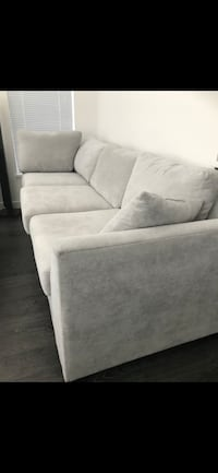 URBAN BARN NEW SECTIONAL COUCH WITH PULL OUT MEMORY FOAM BED Surrey, V3Z
