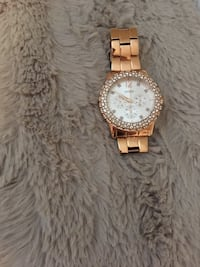 round gold-colored analog watch with link bracelet Ottawa