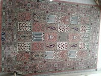 brown, white, and red floral area rug