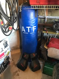 blue leather ATF heavy bag; pair of black boxing gloves