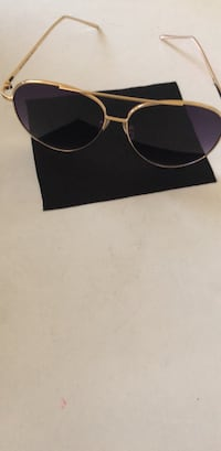 Black sunglasses with gold frames 43 km
