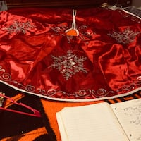 Red  and silver silk tree skirt that  lays under your Xmas tree Hillsboro, 63050