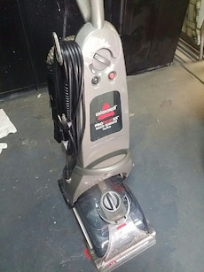 gray and black Bissell vacuum cleaner